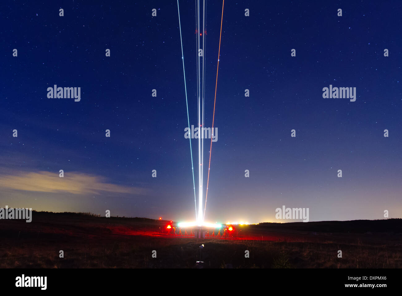 Plane starting at night at an airport, long time exposure - Stock Image