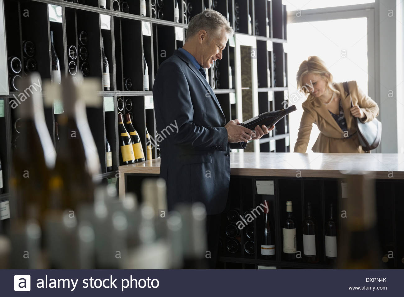 Man shopping in wine store Stock Photo