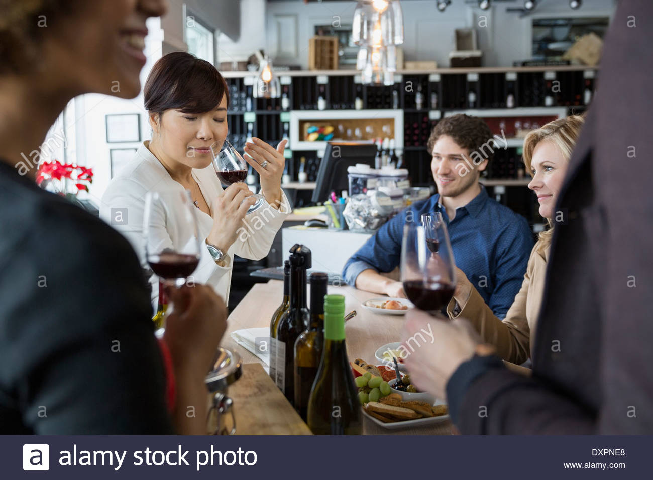 Sommelier and couples wine tasting in store - Stock Image