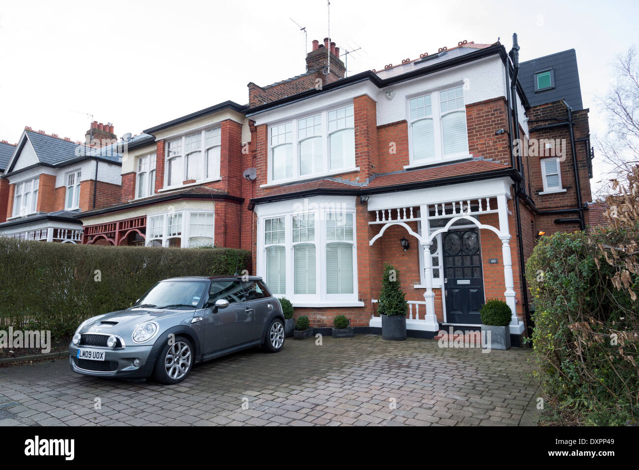 Car parked in paved front garden of a house, Muswell Hill, North London, England, UK - Stock Image