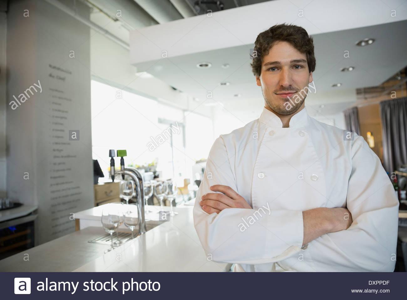 Portrait of confident bistro chef - Stock Image