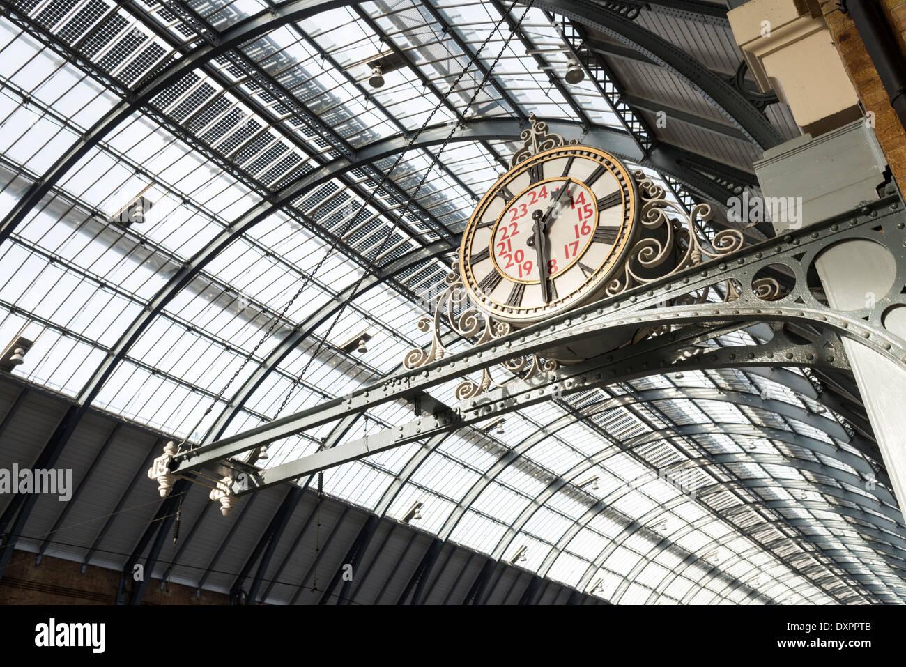 King's Cross station clock, London, England, UK - Stock Image