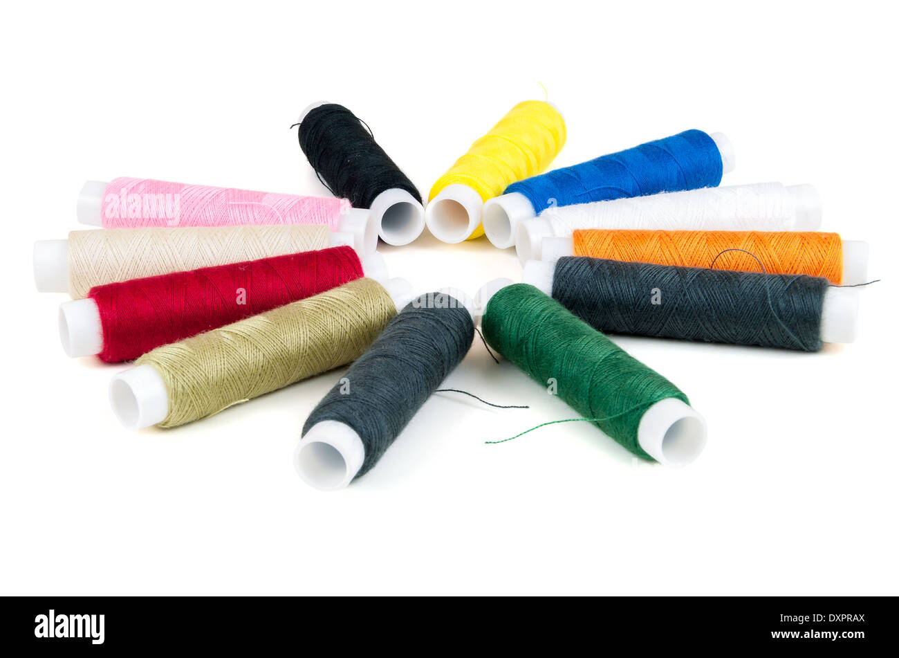Colored spools of threads isolated on white background - Stock Image