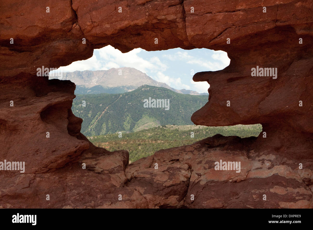 Pikes Peak as seen through the 'window' near the base of the Siamese Twins formation, Garden of the Gods park, Colorado USA - Stock Image
