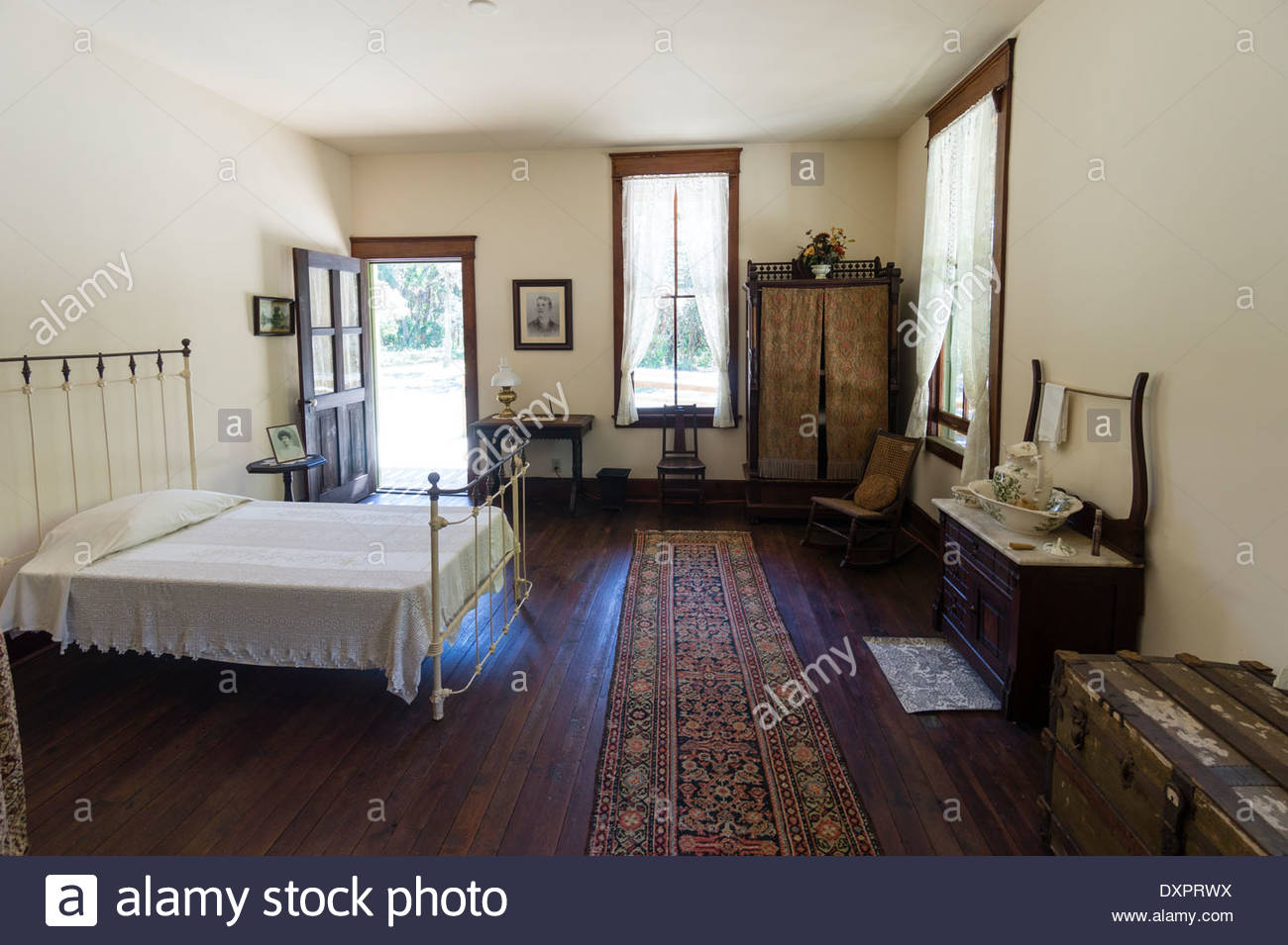 A bedroom in the Planetary Court building at the Koreshan State Historic Site in Estero, Florida - Stock Image