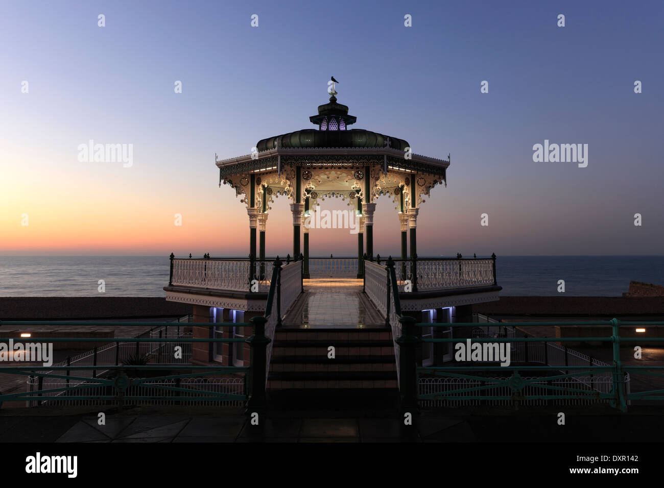 Dawn colours over the Victorian Bandstand, seaside promenade, Brighton City, Brighton & Hove, Sussex, England, UK Stock Photo