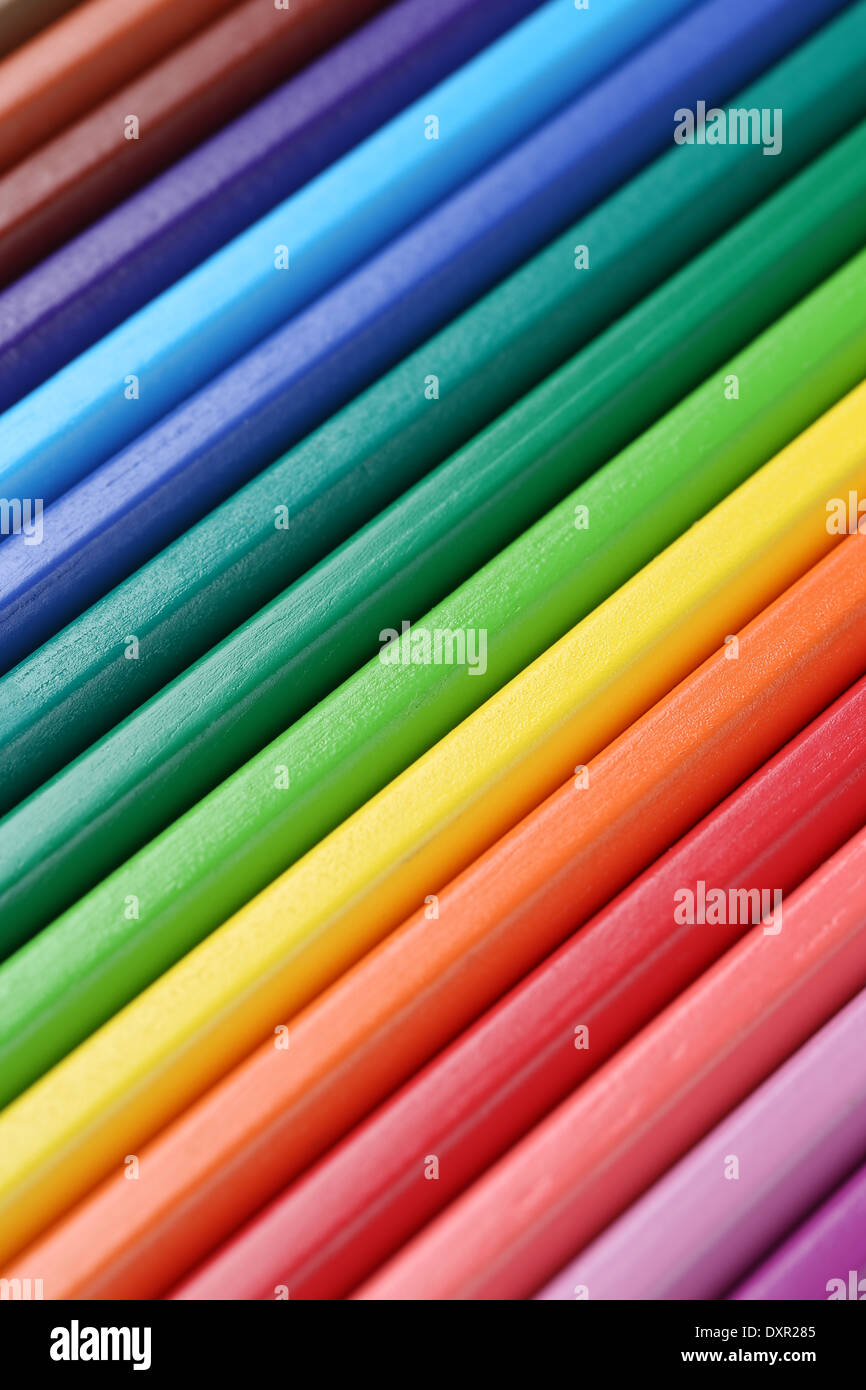 Colored pencils in a row forming a background back to school - Stock Image