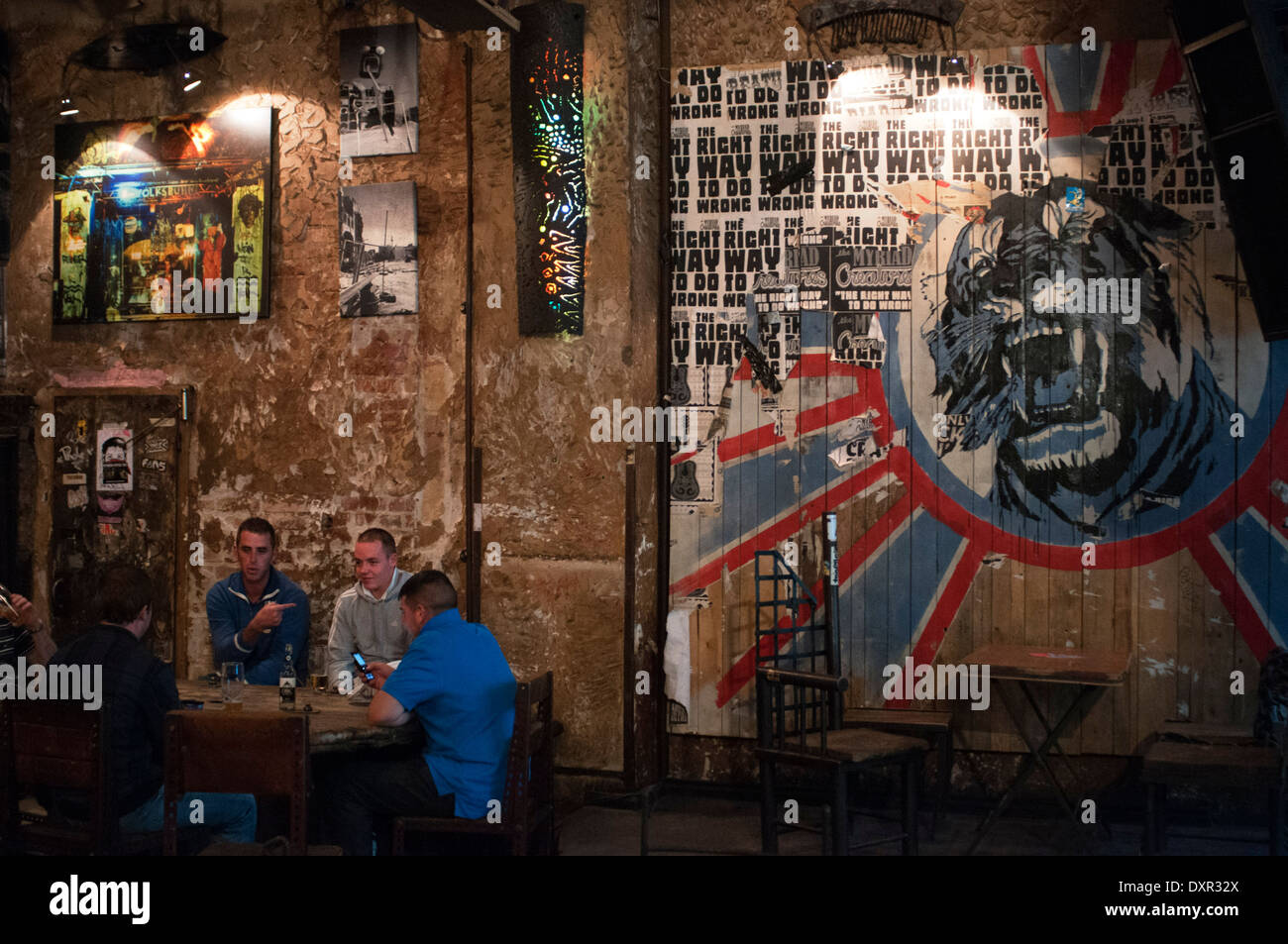 Berlin, Germany, a two-man take a beer in Zapata the Kunsthaus Tacheles. The Kunsthaus Tacheles (Art House Tacheles) was an art - Stock Image