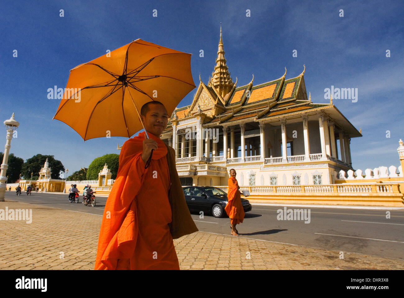 Monk walk outside the Royal Palace. Phnom Penh. The Royal Palace of Cambodia is a complex of buildings, even though Stock Photo