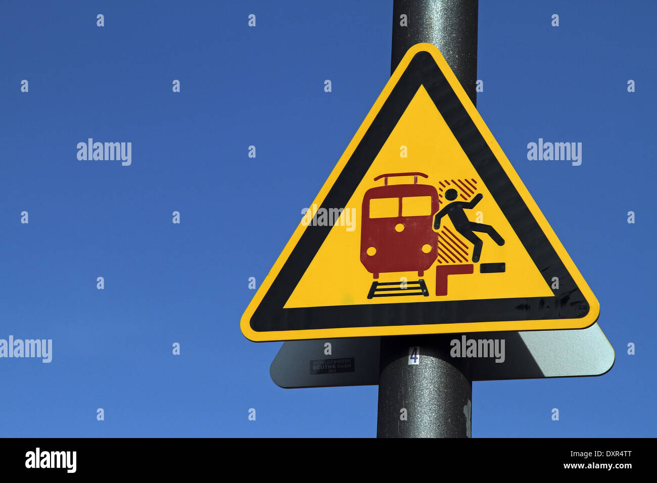 Berlin, Germany, Warning Sign, suction and falling on the platform by passing trains - Stock Image