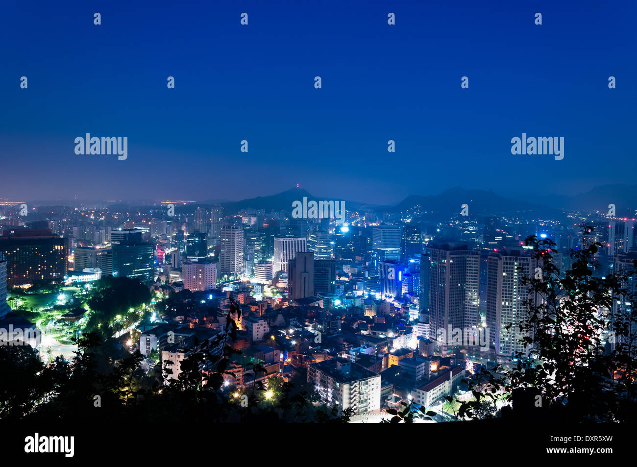 The lights of Seoul glimmer as dawn approaches. - Stock Image