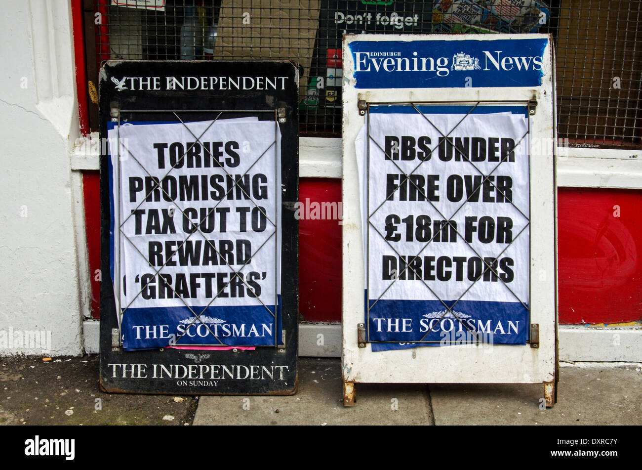 Newspaper A boards outside a newsagent in the centre of Edinburgh with news of tax cuts and RBS Directors. - Stock Image
