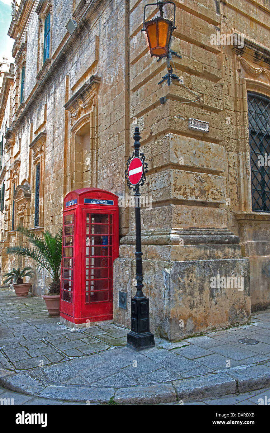A Red Telephone Box Next To A No Entry Sign In Saint Paul's Square, Mdina, Commonly Called 'The Silent City. Malta. - Stock Image