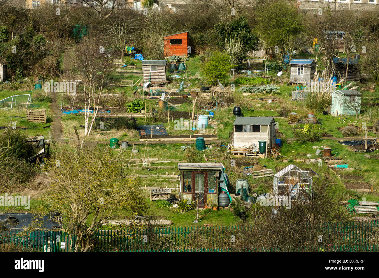 Sheds and allotments alongside railway line into Bristol - Stock Image