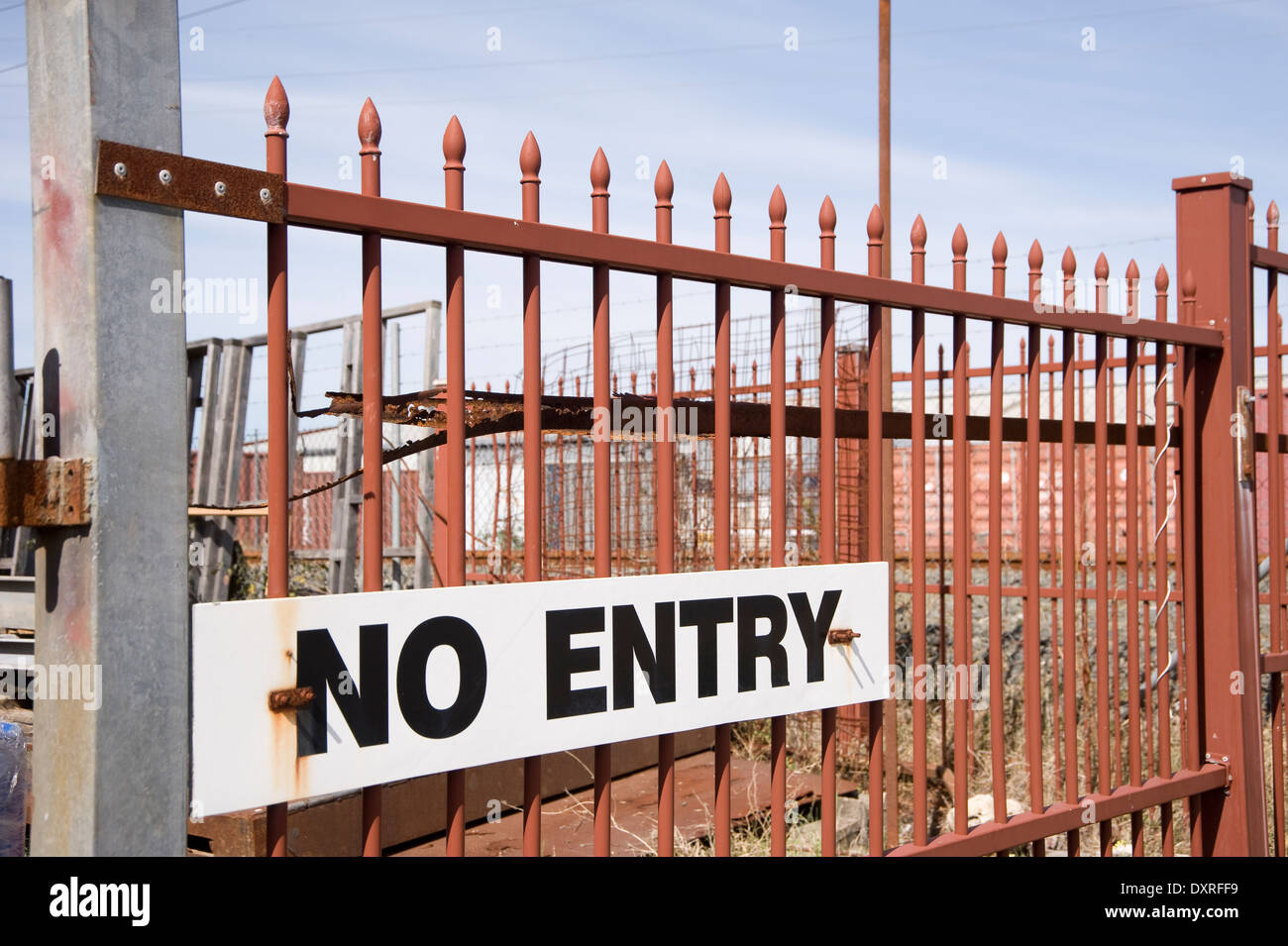 No entry sign on rusty iron security fence - Stock Image