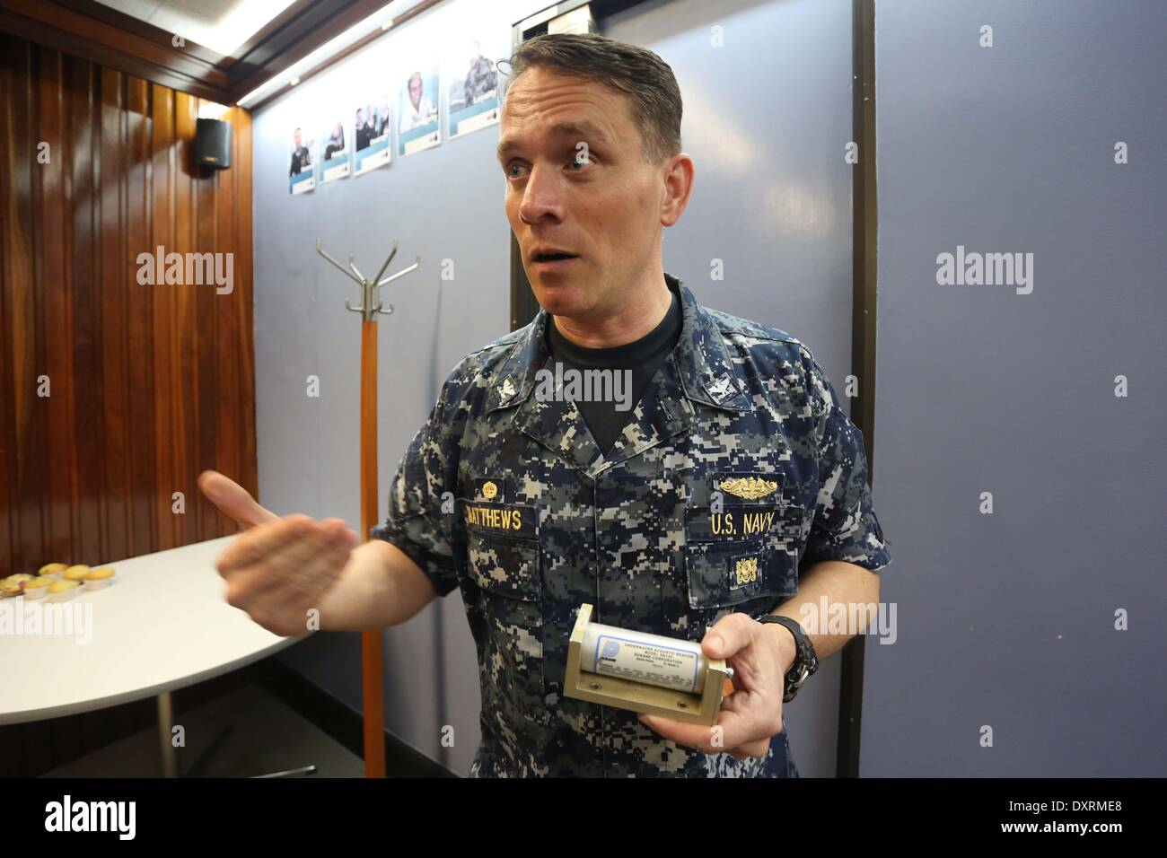Perth, Australia . 30th Mar, 2014. U.S. Navy director of ocean engineering captain Mark Matthews introduces the Stock Photo