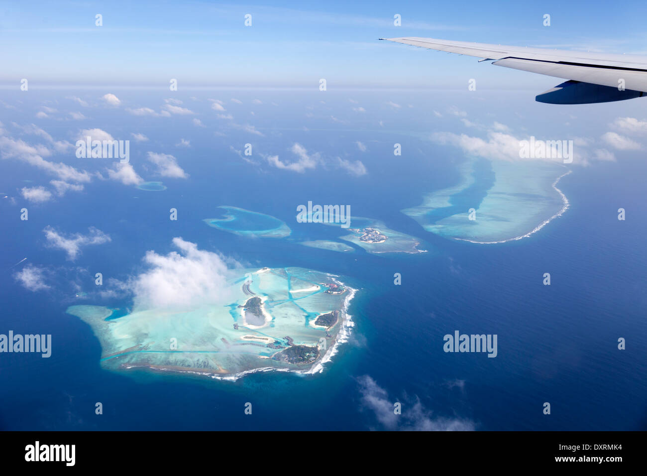 View from the window of an airplane flying above the Maldive Islands in the Indian Ocean 7 Stock Photo