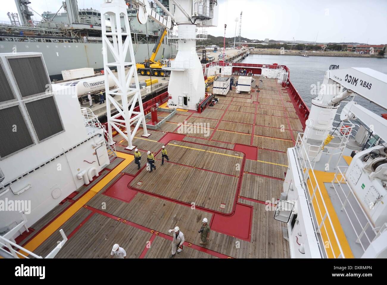 Perth, Australia . 30th Mar, 2014. Australian Defence Vessel Ocean Shield is loaded with supplies and equipments Stock Photo