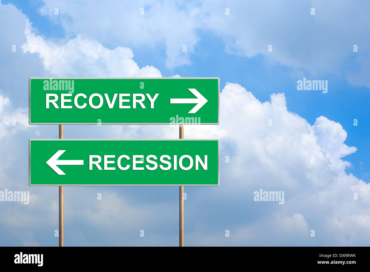 recovery and recession on green road sign with blue sky - Stock Image