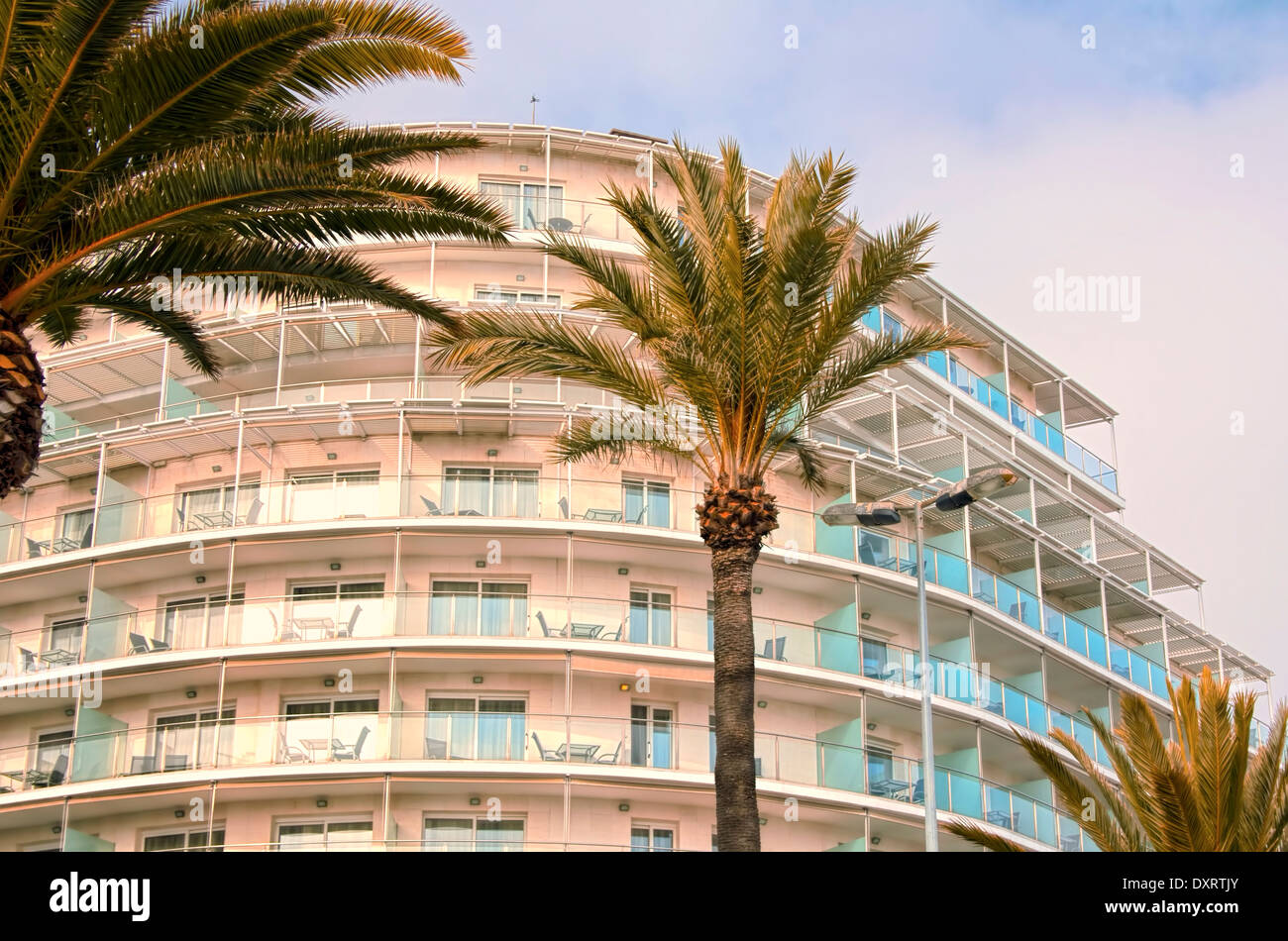 Outdoor View of Building in a Popular Holiday Resort on a Late Sunny Afternoon - Stock Image