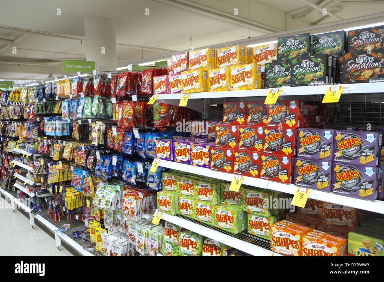 stacked shelves in a coles supermarket,sydney Stock Photo: 68137359