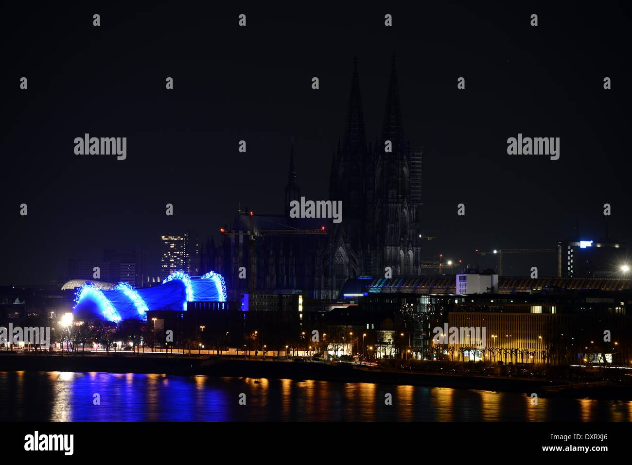 A view of the unlit cathedral during the 'Earth Hour' event in Cologne, Germany, 29 March 2014. 'Earth Hour' is a worldwide event which aims to set a sign for environmental  protection and to draw attention to environmental awareness. Photo: Henning Kaiser/dpa - Stock Image