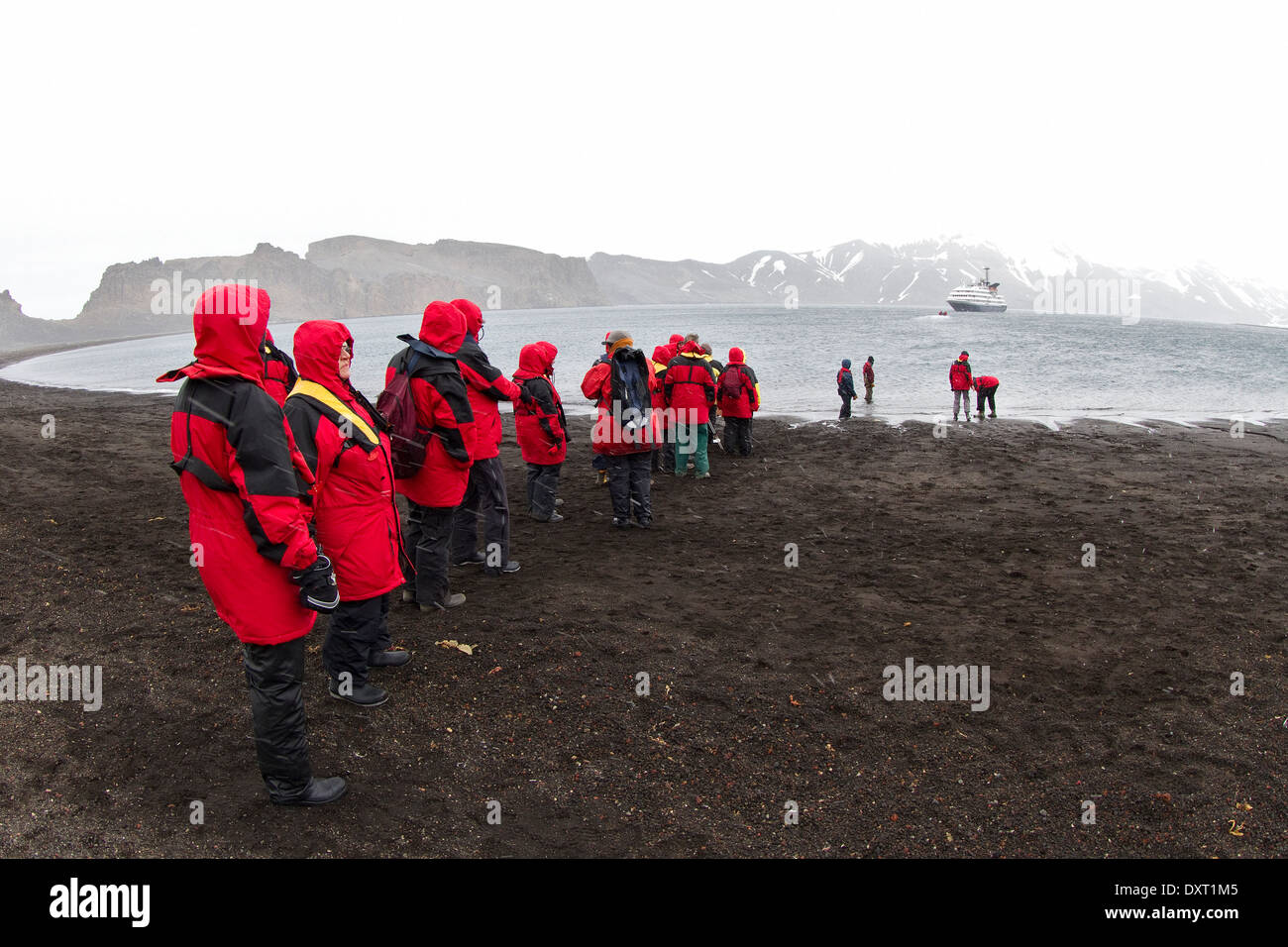 Antarctica cruise ship passengers leaving Whalers Bay, Deception Island by Zodiac. Antarctic tourism. South Shetland Islands. - Stock Image