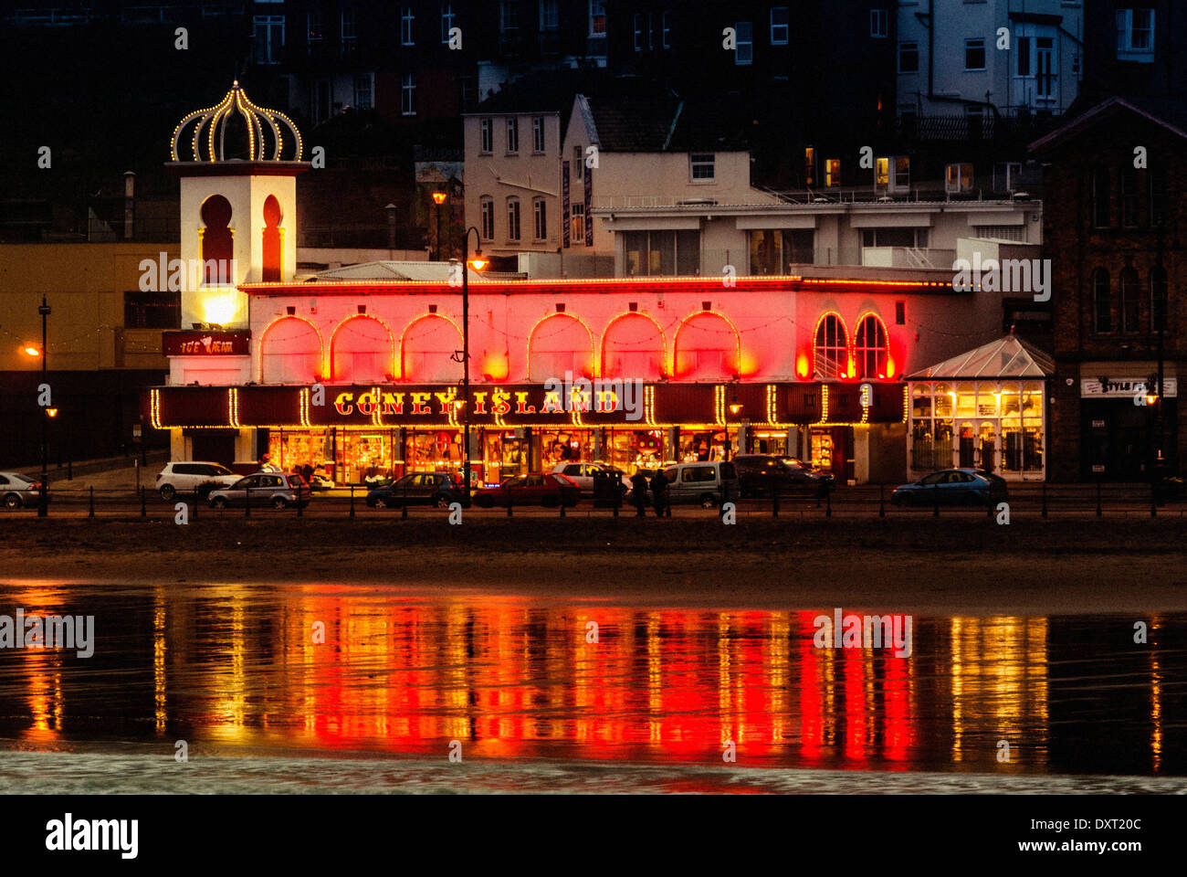 Coney Island Amusements, Scarborough, at night with light reflections in sea - Stock Image