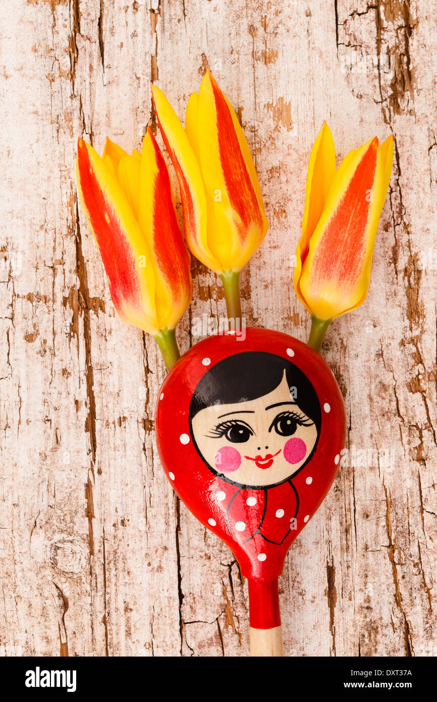 Russian wooden spoons matryoshka with tulips Stock Photo