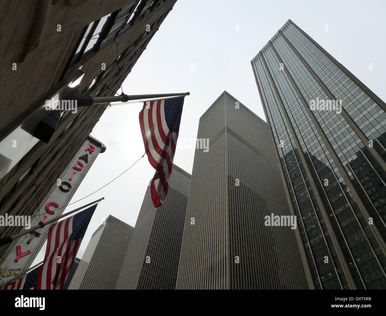 (FILE) - An archive picture, dated 18 August 2014, shows a view of Radio City Music Hall (L) and a skyscraper on 6th Avenue in Manhattan, Newy York, USA. The Radio City Music Hall was built in the 1920s and opened its doors for the first time in 1932. The concert venue is located between 50th und 51st Street and was constructed in the Art Deco Style with geometric ornaments which include glass, aluminium and chrome as the main components of building materials. Photo: Alexandra Schuler - NO WIRE SERVICE - - Stock Image