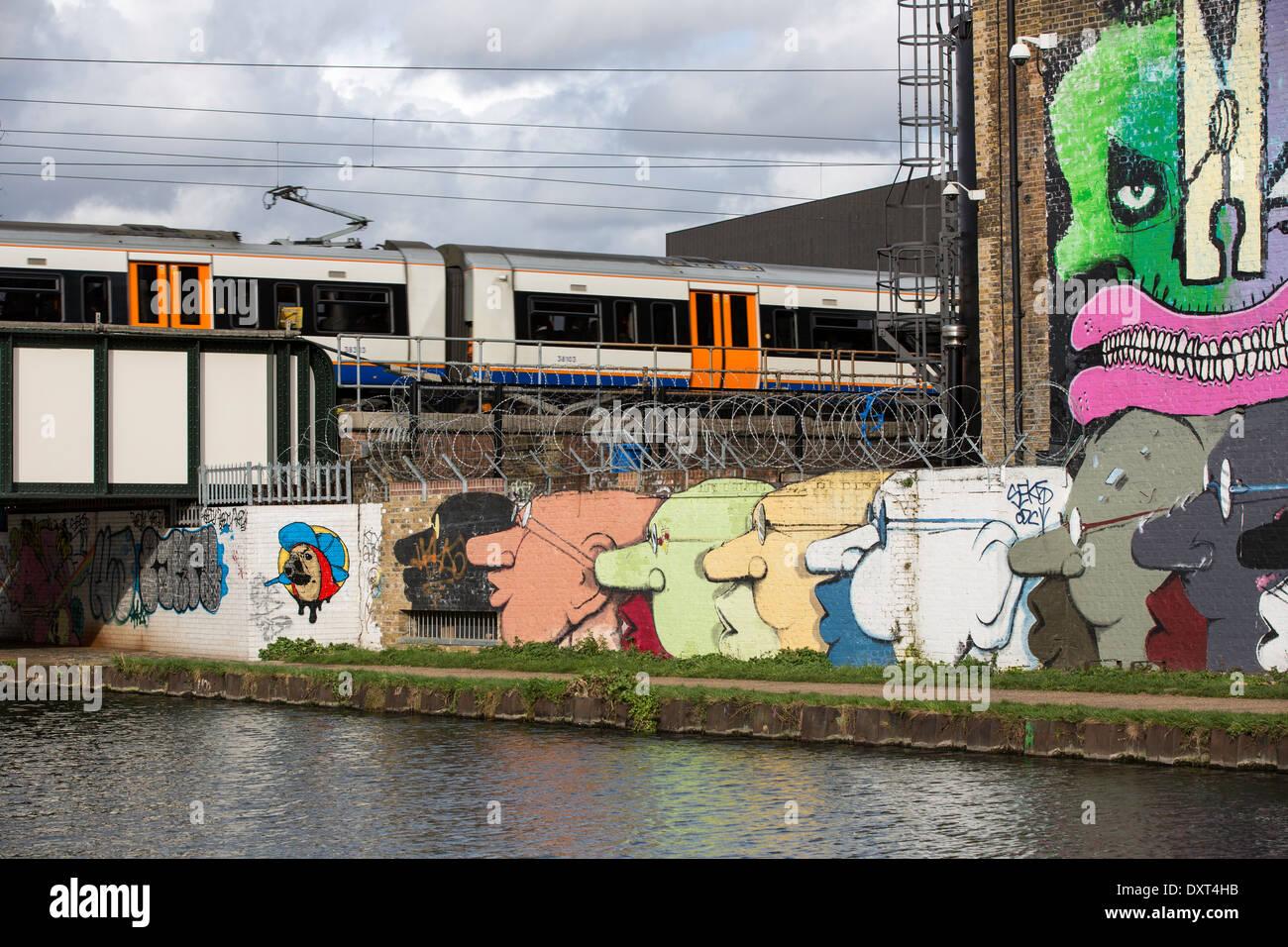 Graffiti on the wall along the Lee River Navigation, Hackney, E9, London, United Kingdom - Stock Image