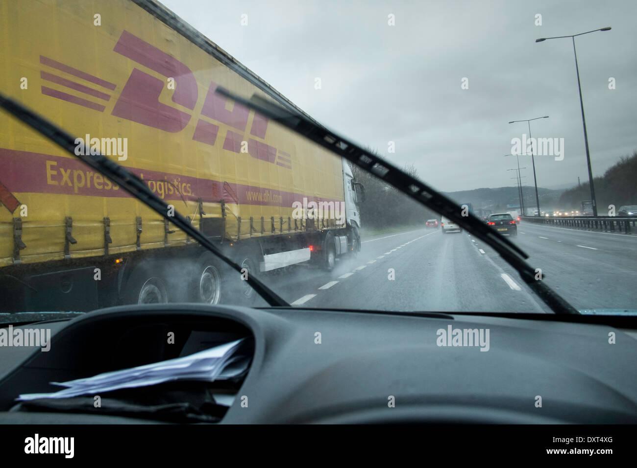 driving bad weather rain motorway danger UK cars - Stock Image