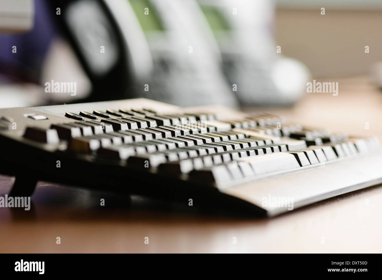 A computer keyboard on an office desk - Stock Image