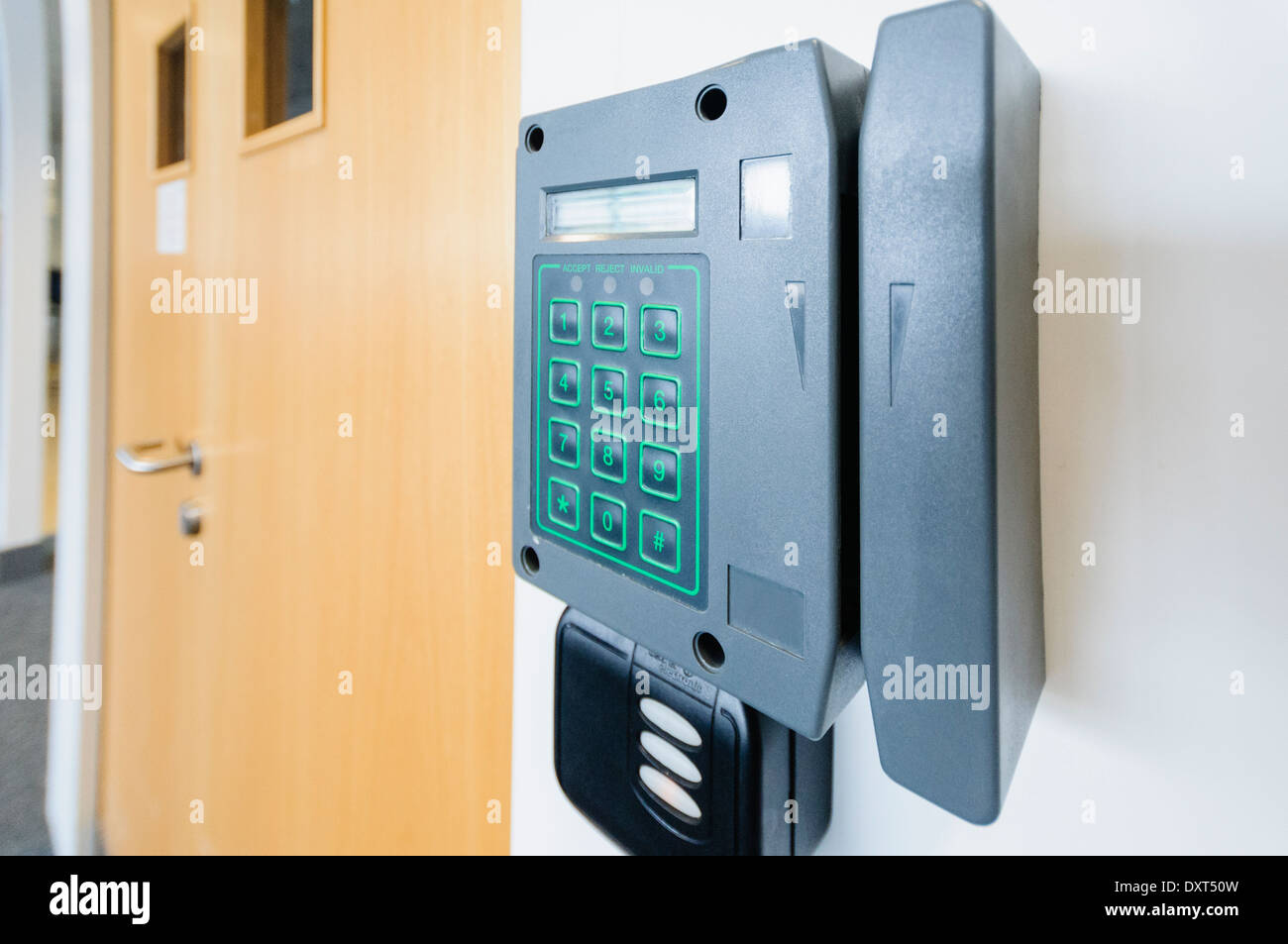 Card reader at an office door to allow access - Stock Image