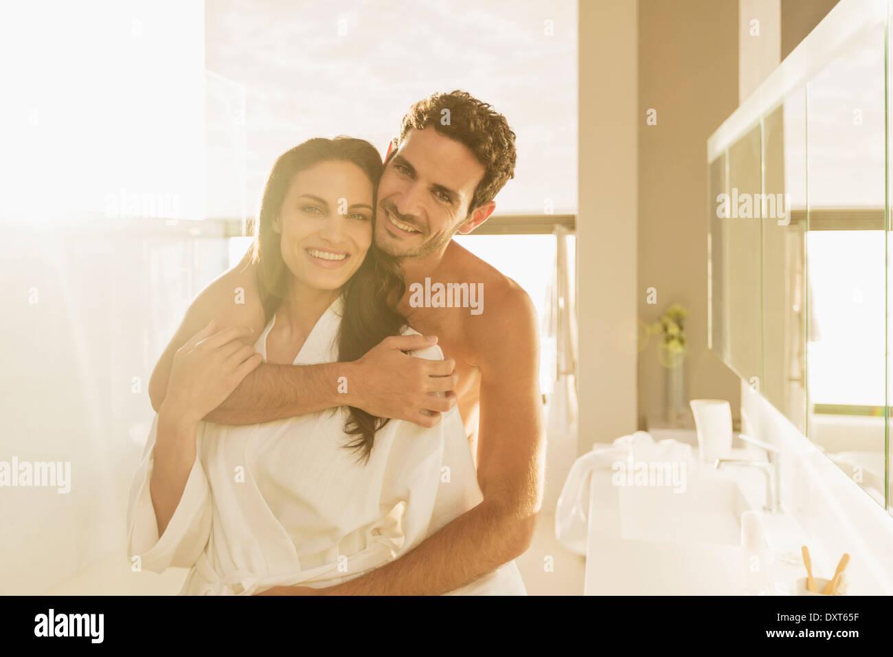 Portrait Of Couple Hugging In Bathroom