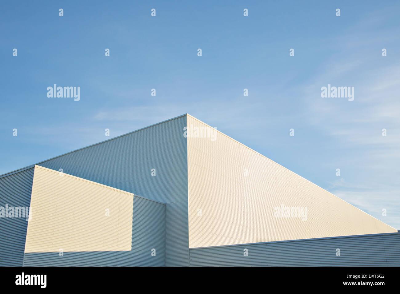 Sun shining on buildings against blue sky - Stock Image