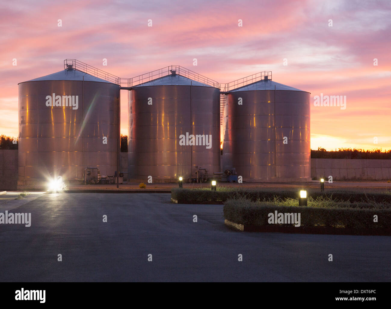Silage storage towers against dramatic sky Stock Photo