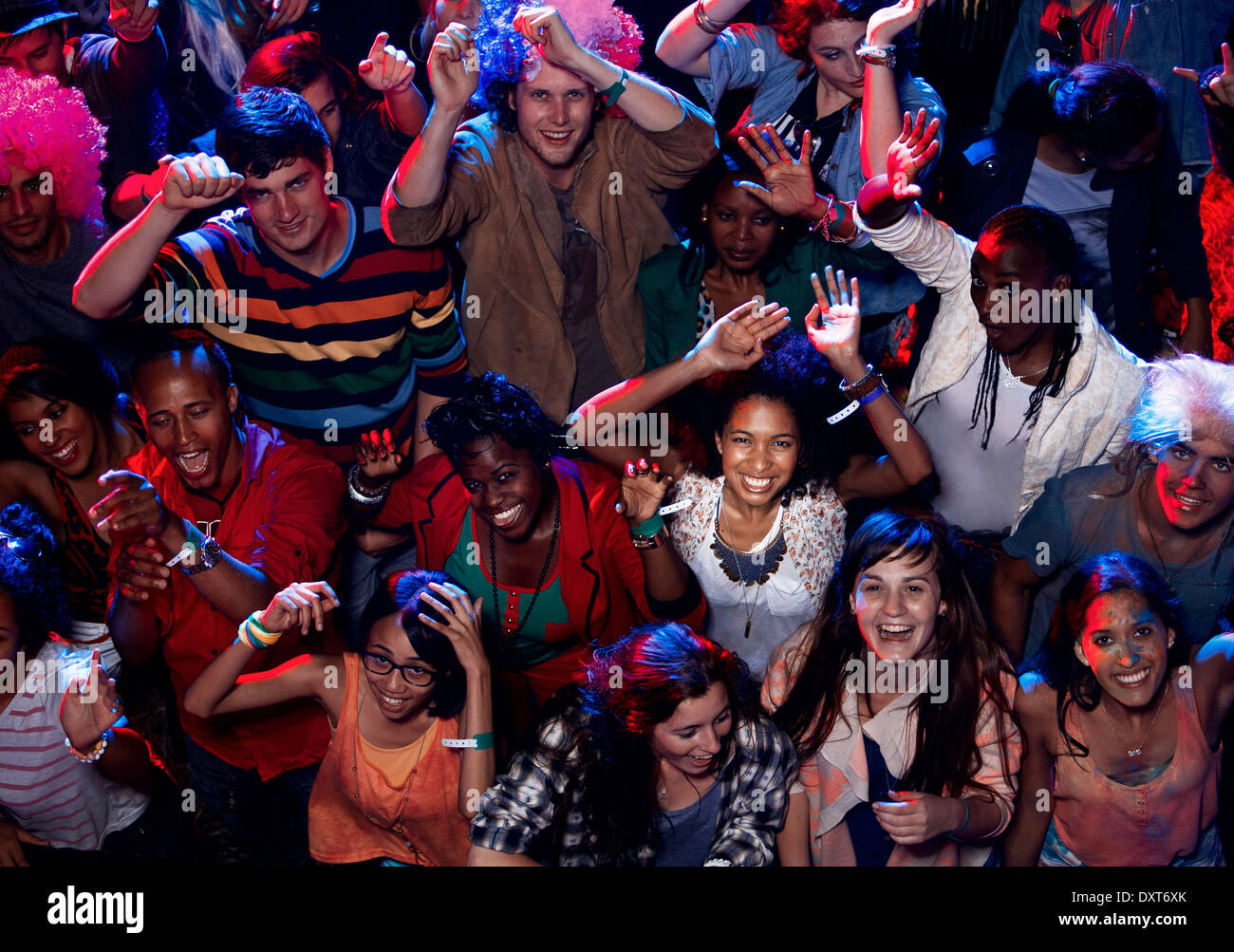 Fans cheering at music festival Stock Photo