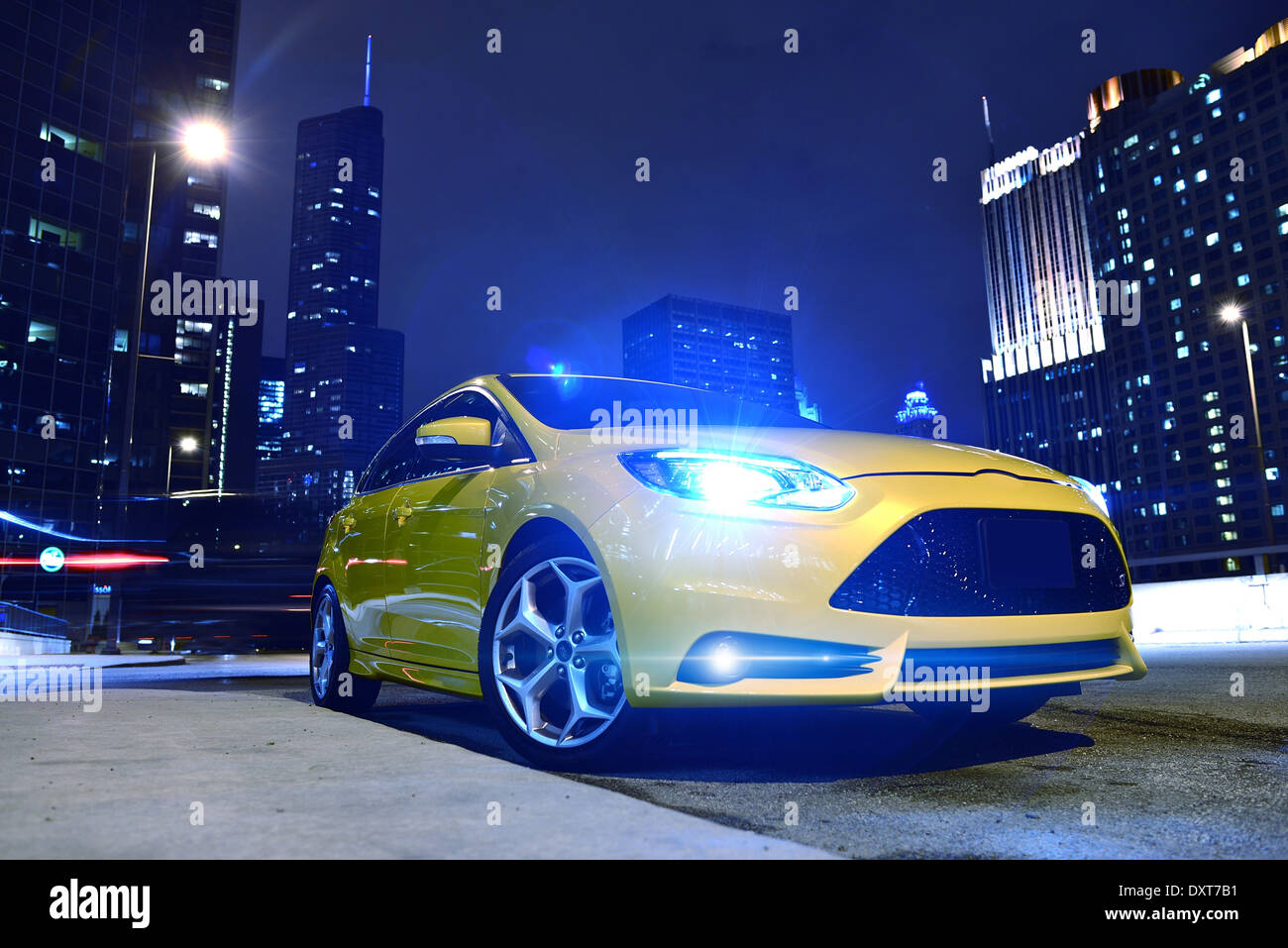 Performance Yellow Car in Downtown Chicago. Fast and Furious. Car at Night - Urban Theme. Performance Vehicles Photography Colle - Stock Image