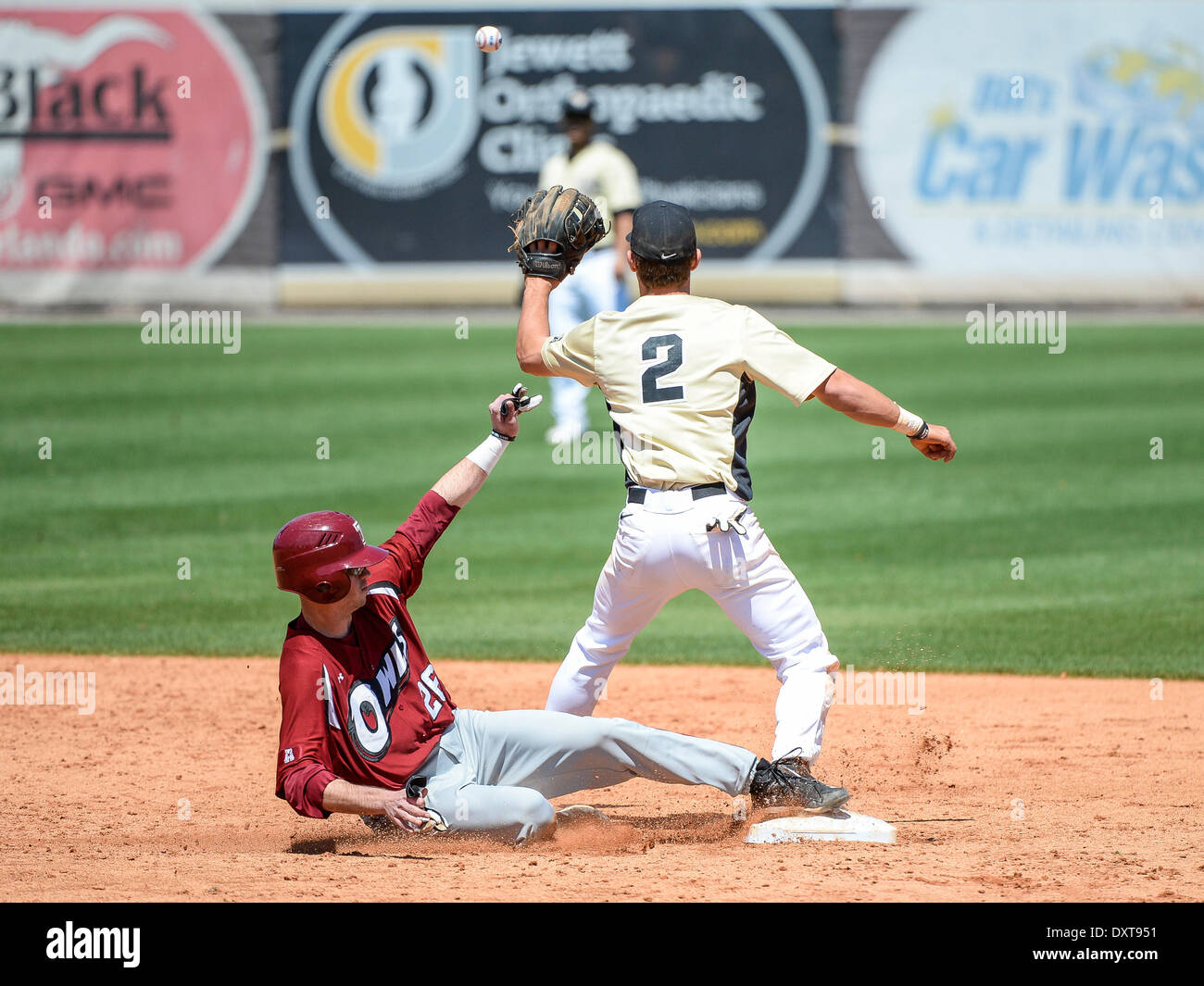 March 30, 2014 - Orlando, FL, U.S: Temple DH Andrew Nist (26) beats the throw to UCF infielder Dylan Moore (2) during NCAA baseball game action between the Temple Owls and the UCF Knights. UCF defeated Temple 12-5 at Jay Bergman Field in Orlando, FL - Stock Image