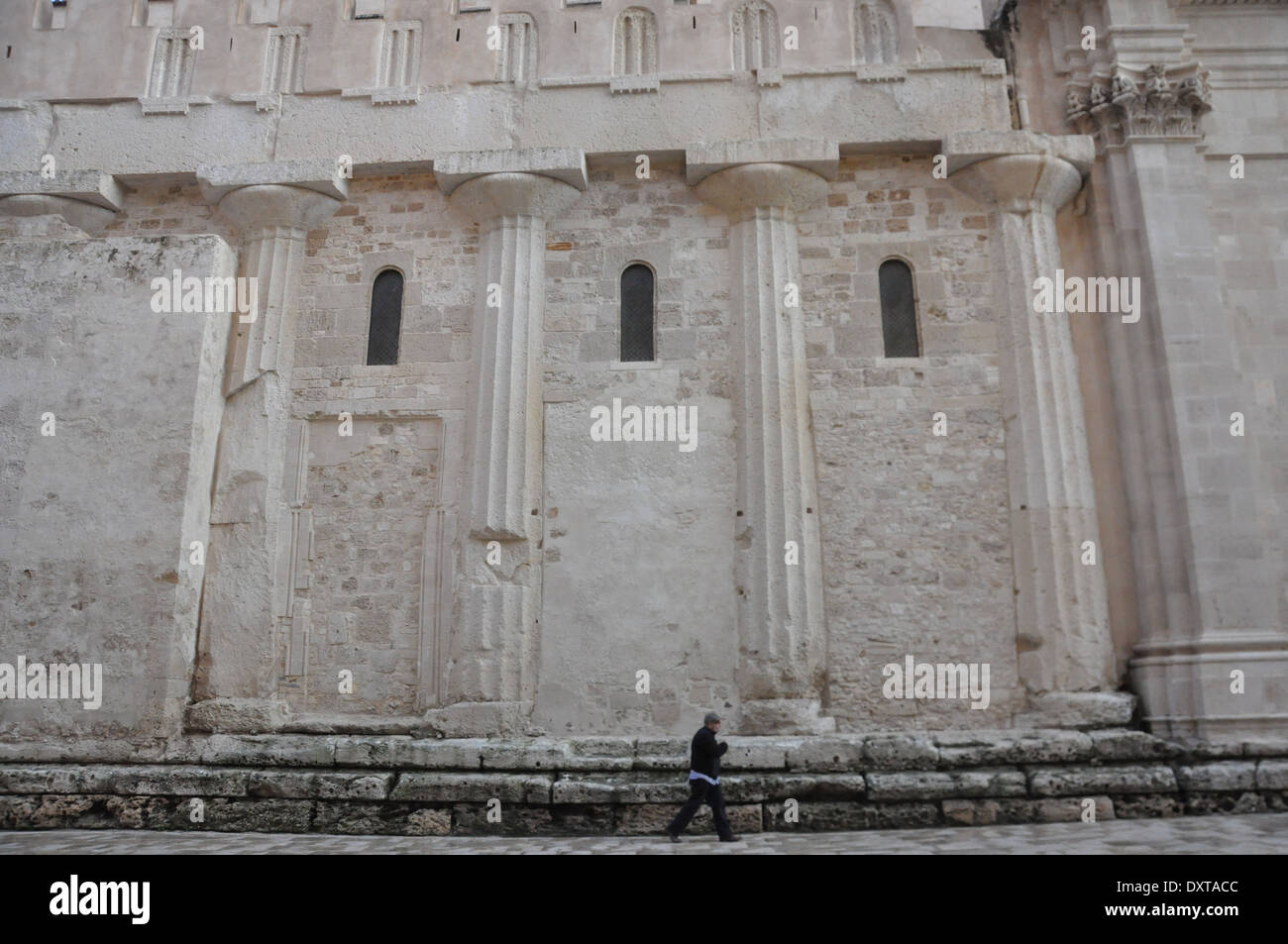 Side of the Cathedral of Syracuse, or Duomo di Siracusa, built over the  great Temple of Athena, with the original Doric columns - Stock Image