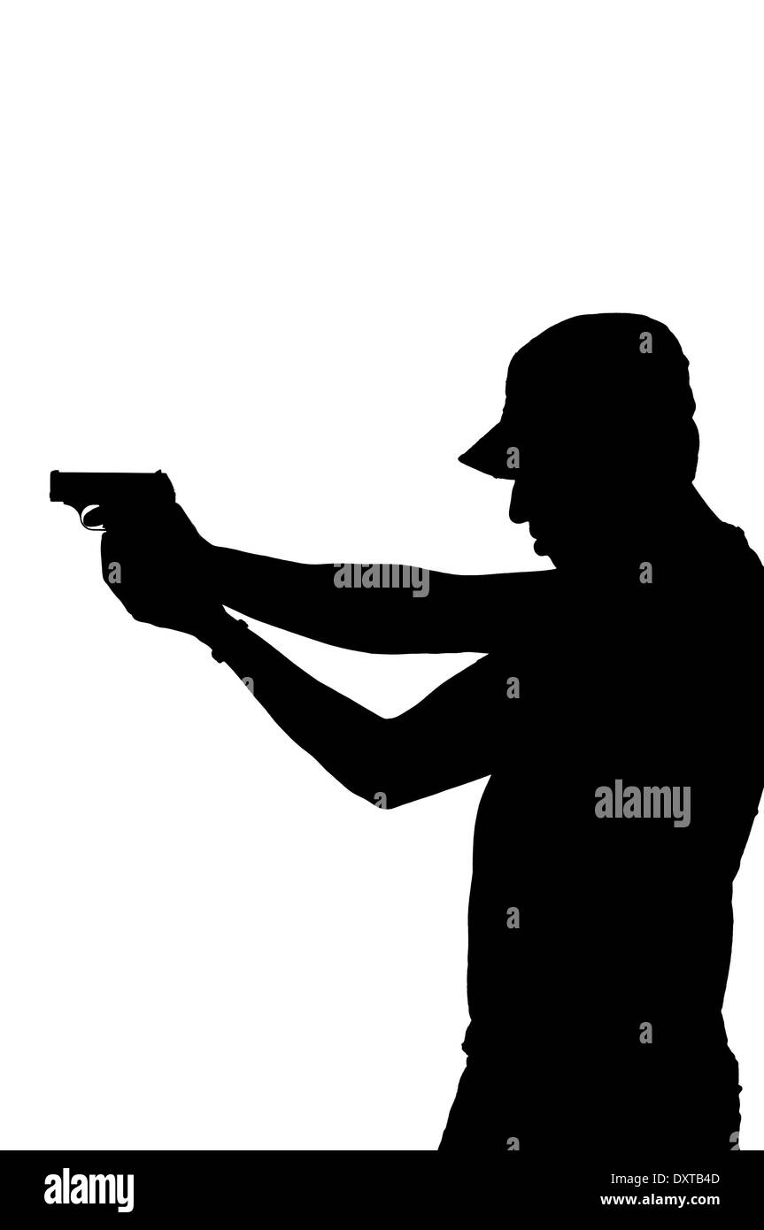 silhouette of a young male pointing gun. - Stock Image