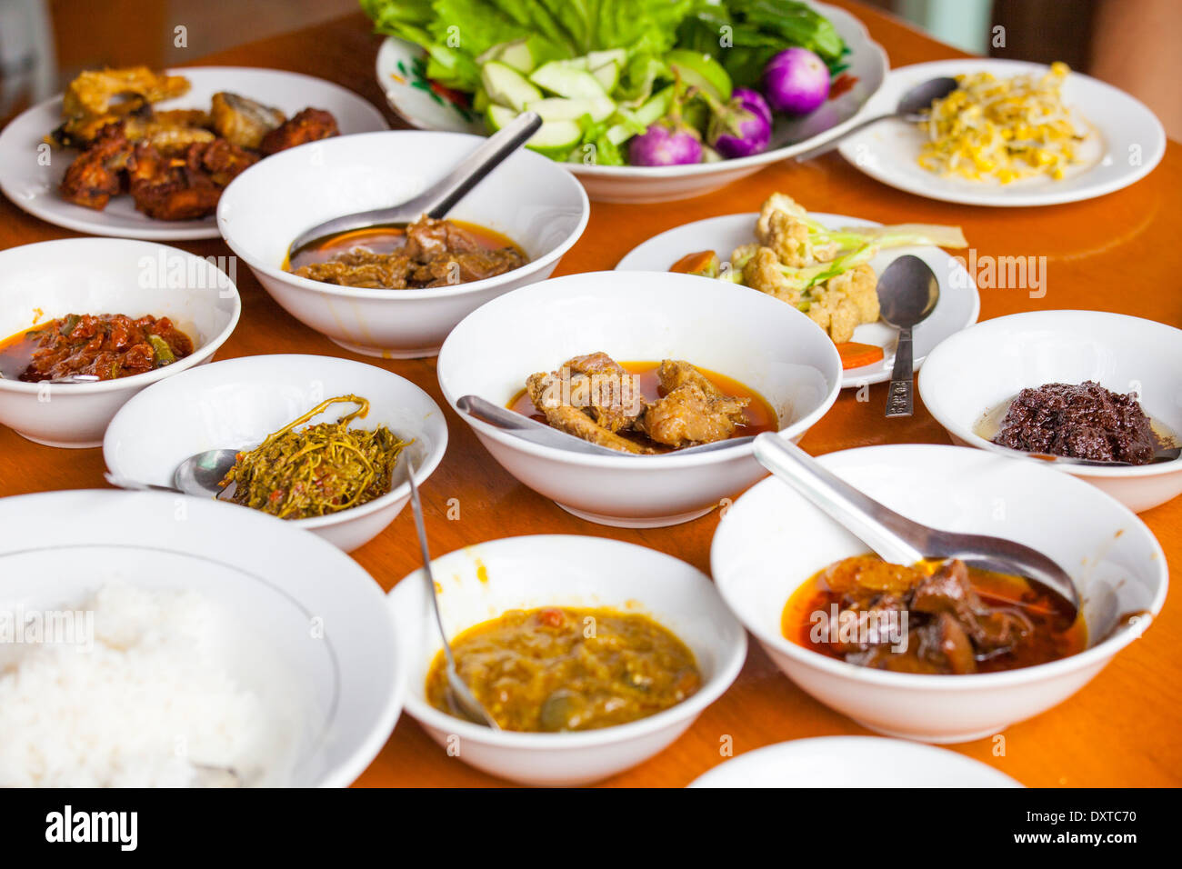 Typical Burmese food at a restaurant in the ruins of Bagan, Myanmar - Stock Image