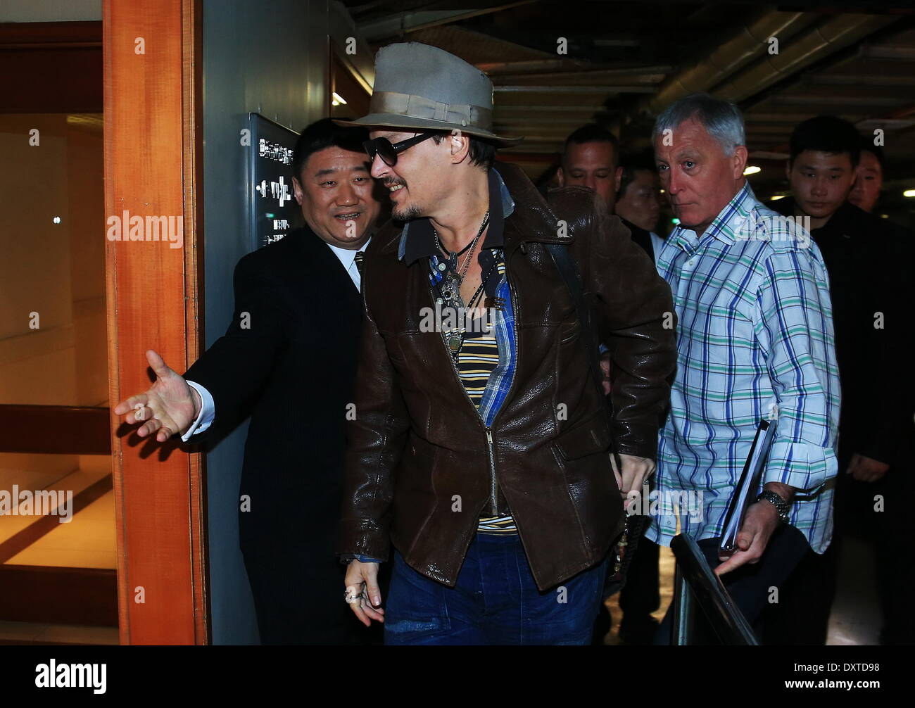 Beijing, China. 31st Mar, 2014. Johnny Depp (C) arrives at a hotel in China's Beijing for the promotion of upcoming film 'Transcendence,' March 30, 2014. Credit:  Xinhua/Alamy Live News - Stock Image