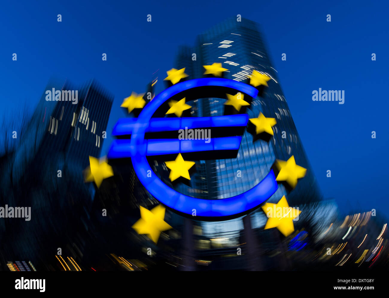 Frankfurt, Germany. 20th Mar, 2014. The stars of European Union (EU) membership sit on a euro sign sculpture outside the headquarters of the European Central Bank (ECB) in Frankfurt, Germany, 20 March 2014. © dpa/Alamy Live News - Stock Image