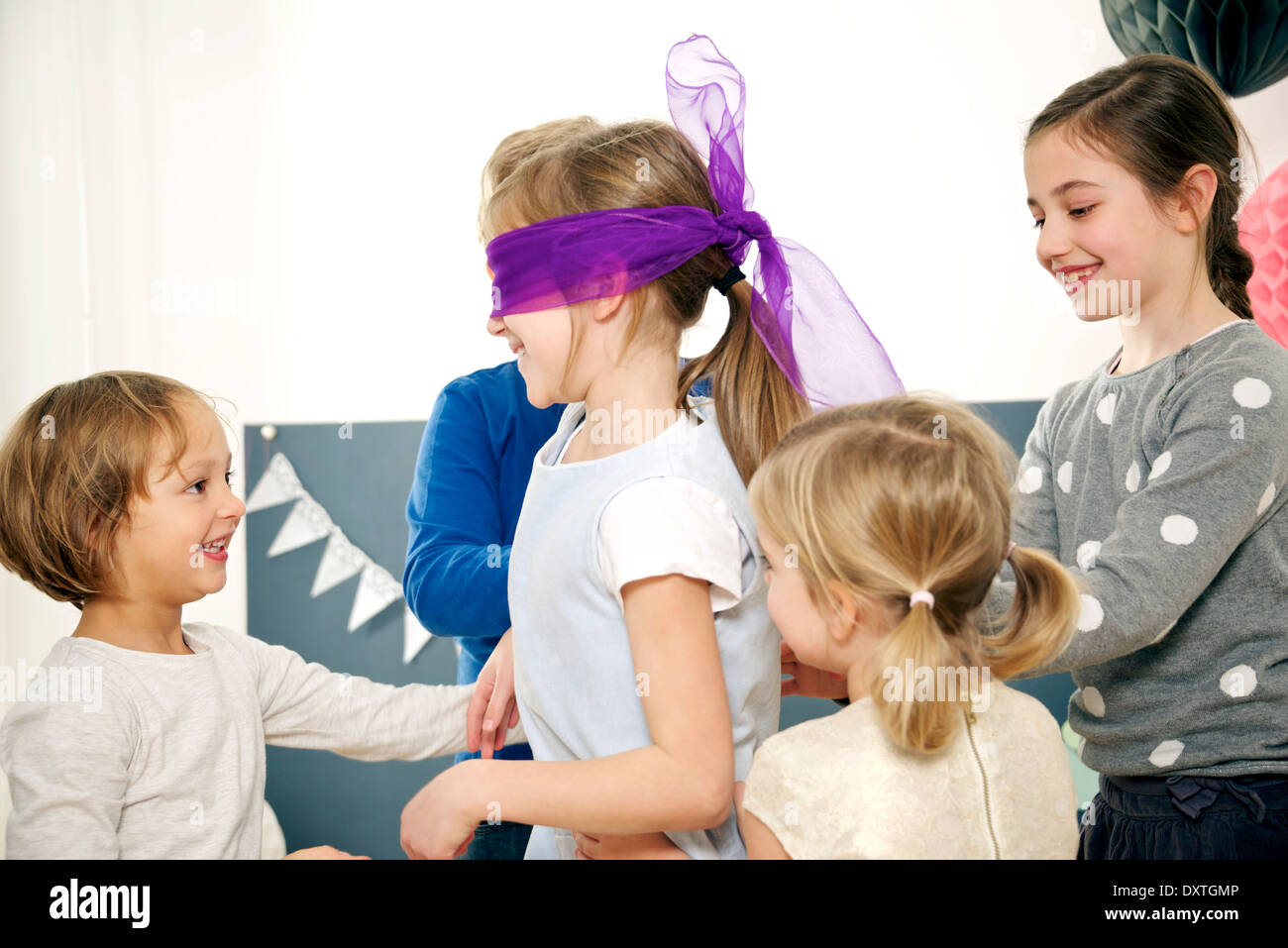 Children on birthday party playing Blind Man's Bluff, Munich, Bavaria, Germany - Stock Image
