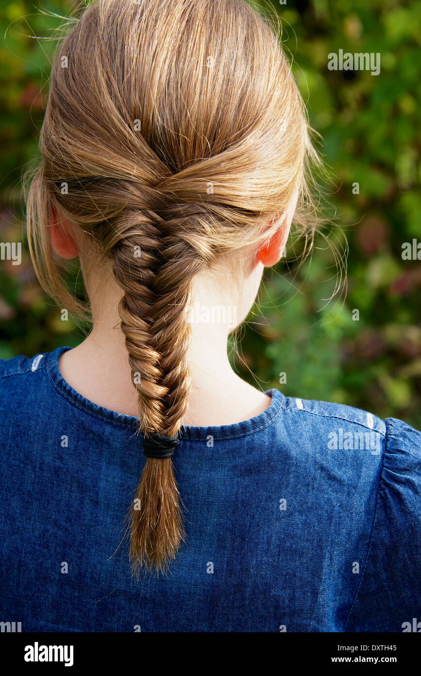 Girl with pigtail, rear view - Stock Image