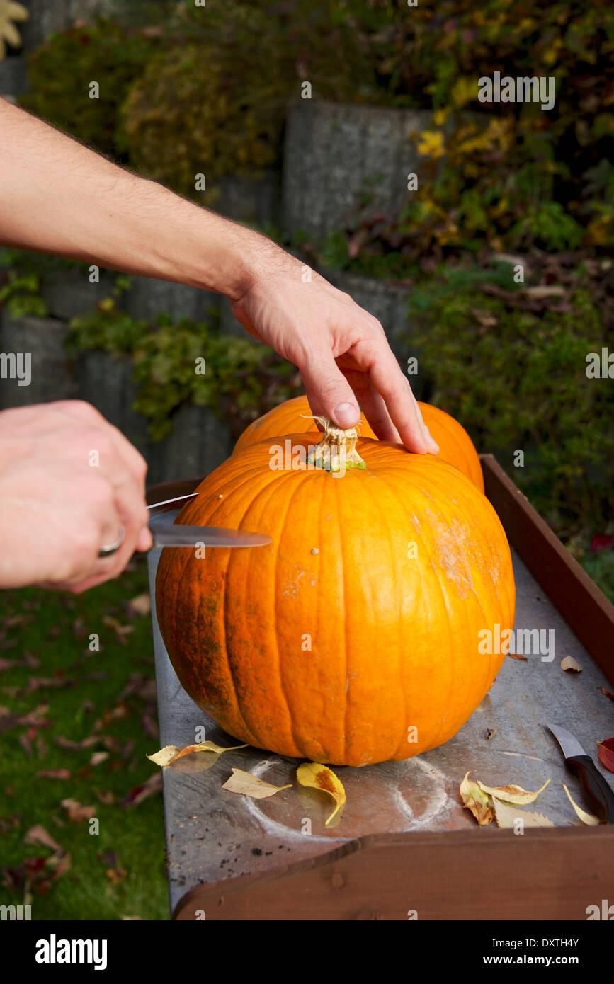 Person carving Jack O'Lantern - Stock Image