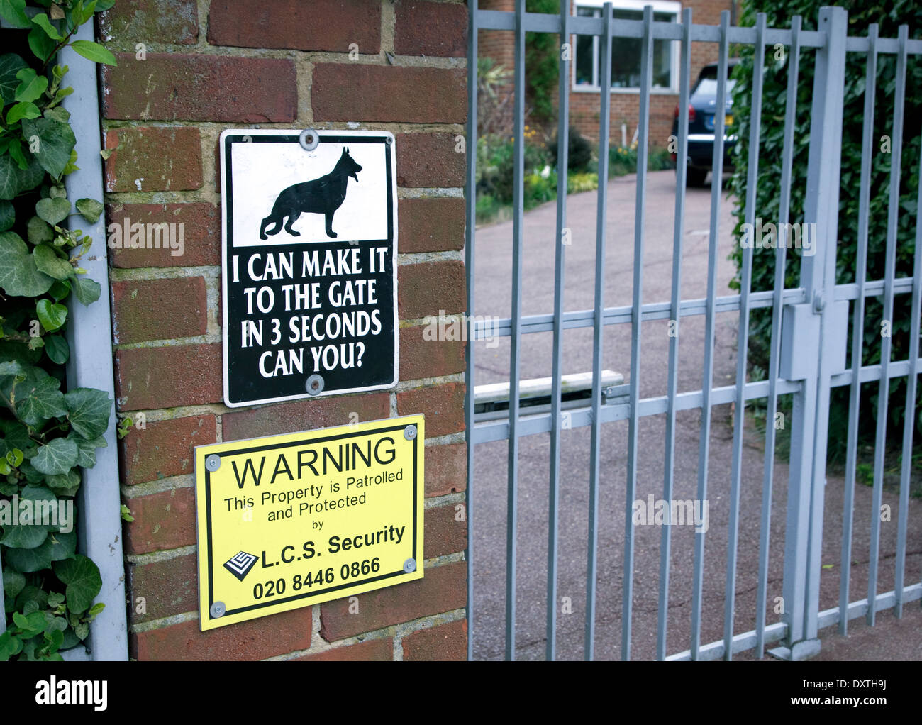 Security warning sign outside house in wealthy area of London - Stock Image