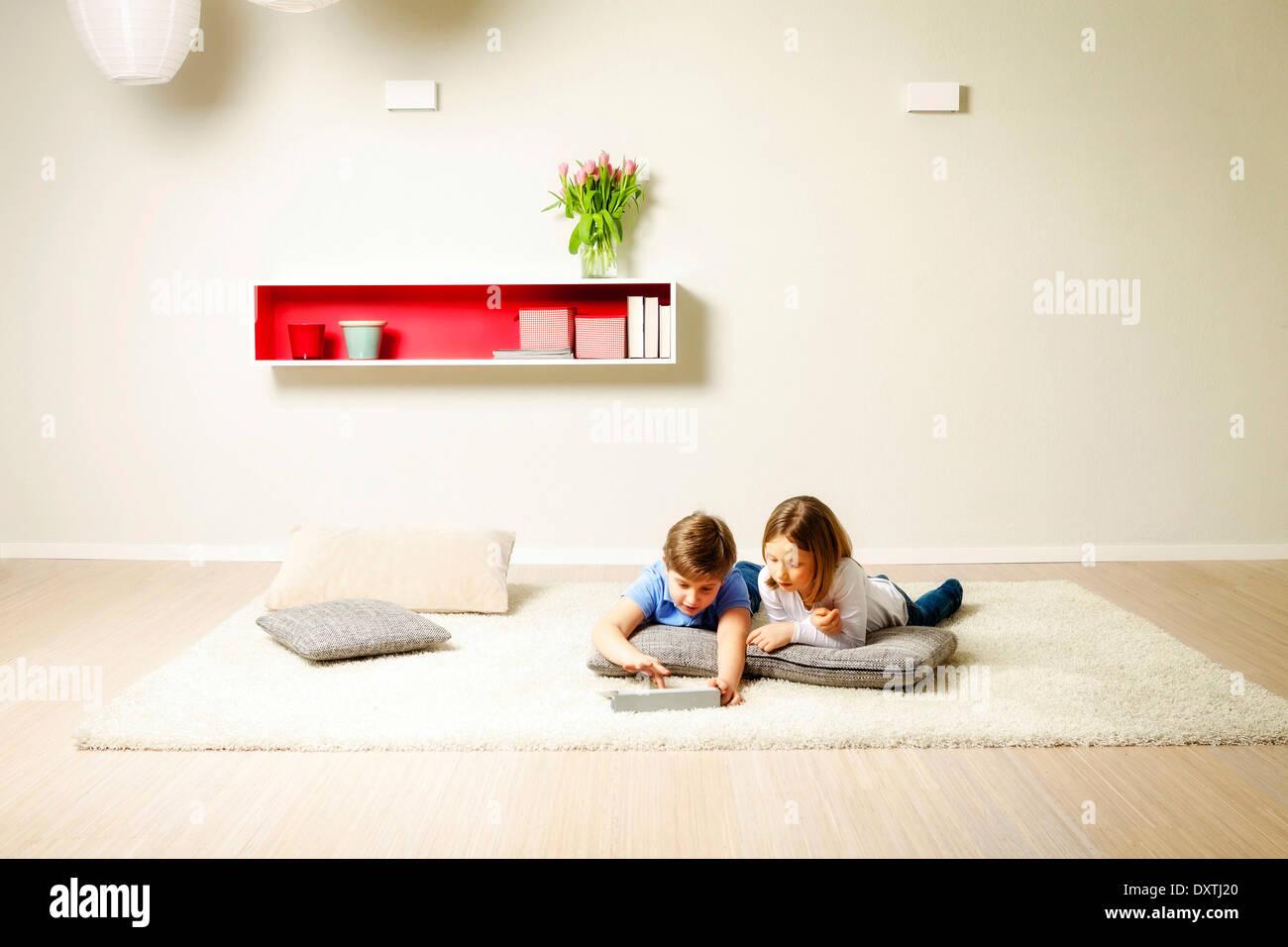 Children using computer at home, Munich, Bavaria, Germany - Stock Image